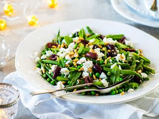 Green beans, peas with feta, olives and pine nuts