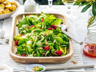 Green salad with shaved cucumber, peas, mint and raspberry dressing