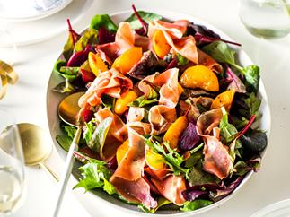 Roasted peach, beetroot and parma ham salad with pomegranate molasses dressing