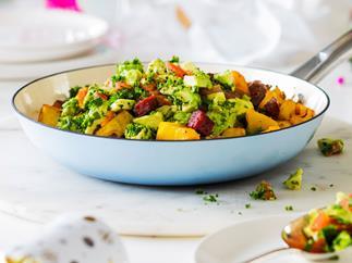 Kumara, potato and chorizo hash with tomato and avocado herb salad