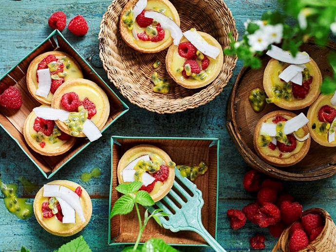 """**[Passionfruit curd tarts with raspberries and coconut](https://www.womensweeklyfood.com.au/recipes/passionfruit-curd-and-coconut-tart-with-raspberries-1827