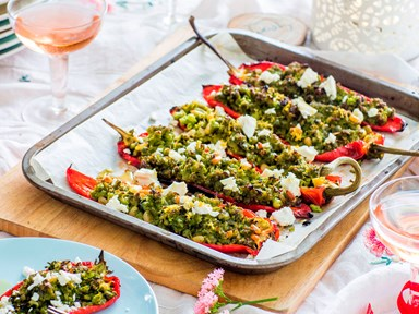 Roast peppers stuffed with peas, pine nuts and feta