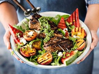 Barbecue lamb skewers with pistachio pesto and grilled fruit salad