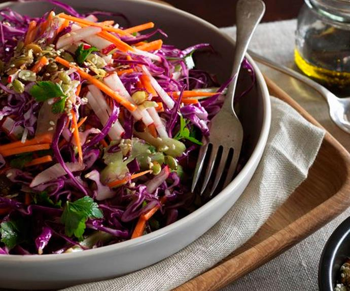 Red cabbage winter slaw with orange dressing and salted seeds