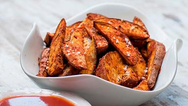 Cajun kumara wedges with BBQ sauce