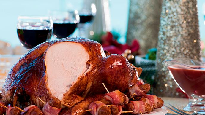 Pomegranate-glazed turkey with cranberry and pancetta stuffing