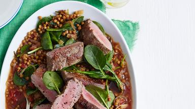 Roast lamb with braised lentils