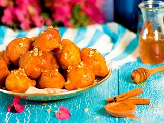 Loukoumades (Greek doughnuts) with honey and cinnamon