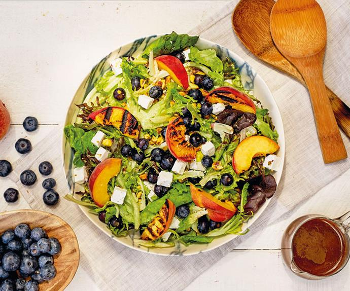 Fancy lettuce, blueberry, goats' cheese and barbecued peach salad