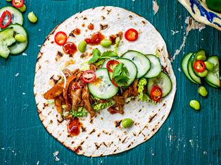 Roast duck tacos with pickled cucumber and spicy barbecue sauce