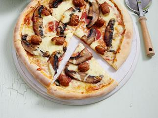 Italian sausage and pepperoni pizza with rocket salad