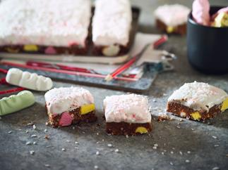 Chocolate lolly cake slice with gooey marshmallow frosting