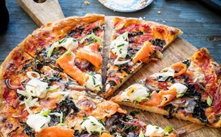 Salmon, caper and red onion pizza