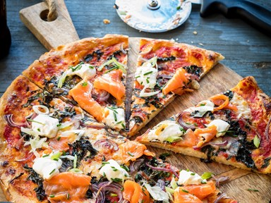 Smoked salmon, caper and red onion pizza with rocket