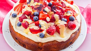 Berry trifle cake with custard, jelly and almonds