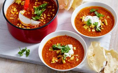 Spiced tomato and lentil soup with corn and coriander