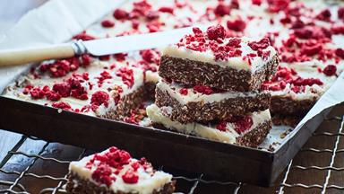 Chocolate slice with raspberry and lemon topping