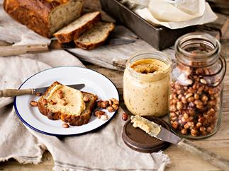 Banana bread with sweet nut butter and toasted peanuts