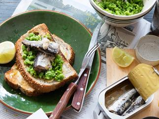 Crushed lemony peas and sardines on toast