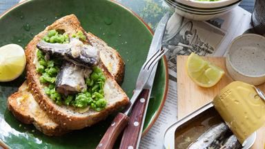 Sardines on toast with crushed lemony peas