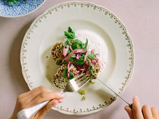 Broad bean falafel with preserved lemon yoghurt and red onion sumac salad
