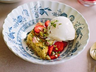 Honey almond cake with pistachios, strawberries and hibiscus rose syrup