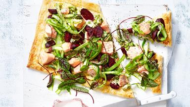 Salmon and beetroot tart with broad bean and pea topping