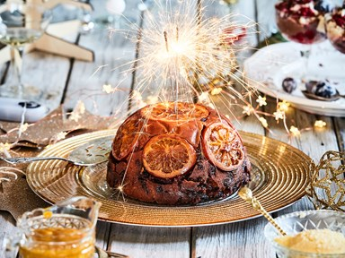 Orange Christmas pudding with honey and citrus sauce