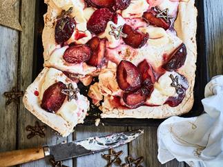 Brown sugar and walnut meringue with cinnamon plums