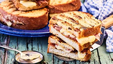 Grilled French toasted sandwiches with mustard, ham and gruyère cheese