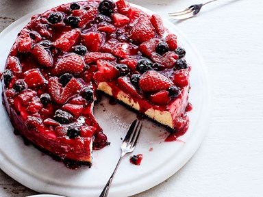 Baked cheesecake with berry sauce and cookie base