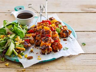 Sticky maple bacon and chicken skewers with cherry pecan salad