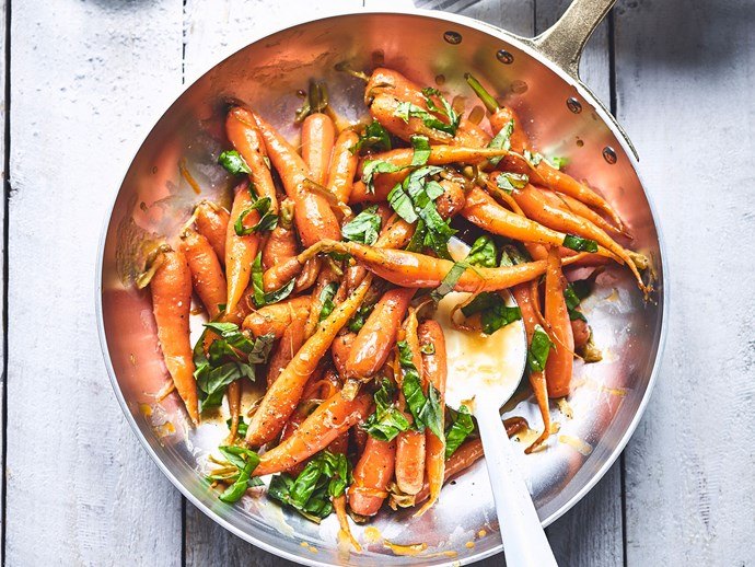 Cranberry, orange and brown sugar glazed carrots with basil