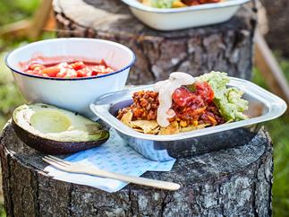 Make-ahead beef nachos with guacamole and chipotle sour cream