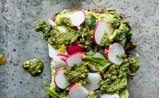 Avocado cream, baby beet leaves and radish with chermoula on five-grain