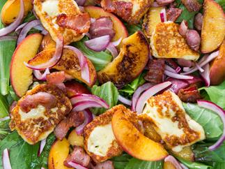 Juicy grilled peach, bacon and haloumi salad