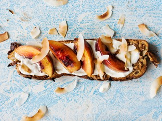 Fruit toast with almond butter, Greek yoghurt and seared peaches