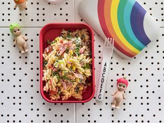 Lunchbox pasta salad with salami, corn and honey mustard