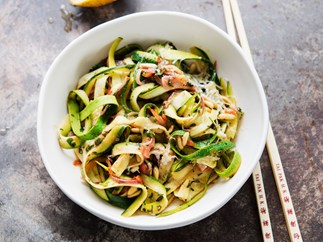 Courgette noodles with a warm pine nut and herb dressing
