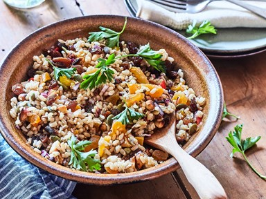 Healthy brown rice salad with sultanas, seeds and nuts