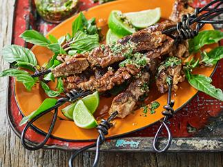 Grilled pork skewers with coriander and lime dipping sauce