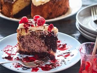 Fresh berry Neapolitan cake with vanilla cream cheese icing