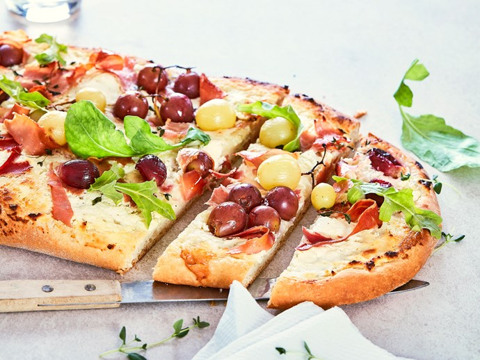 Grape, prosciutto and goat's cheese pizza with rocket