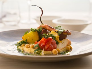 Bazaar Restaurant's confit octopus with hummus, spiced chorizo, tomato and parsley
