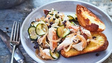Bruschetta with smoked fish, pickled cucumber and currants