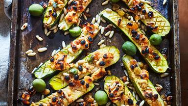 Grilled cheesy courgettes with pine nuts and olives