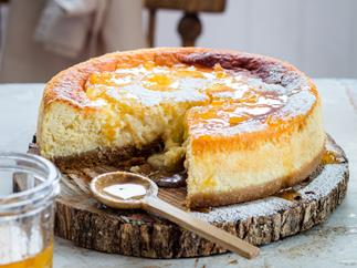 Baked lemon and ricotta cheesecake with marmalade syrup