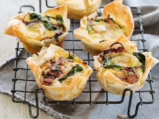 Brie and bacon filo tarts with spinach and pine nuts