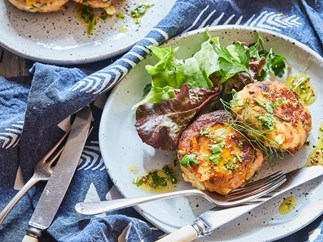 Hot smoked salmon and potato cakes with herby dressing