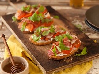 Bruschetta with roasted persimmon and prosciutto